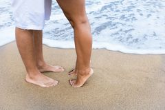 Couple feet on the beach Royalty Free Stock Image