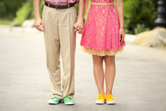 Couple feet with color sneakers Stock Photos