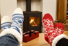 Christmas couple feet in front of fire royalty free stock photography