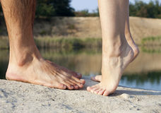 Couple feet kissing near lake Stock Photography