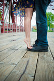 Couple feet. Perspective of a couples feet on a bridge Royalty Free Stock Image