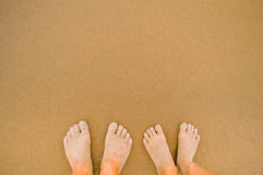 Couple feet in sand Royalty Free Stock Photography
