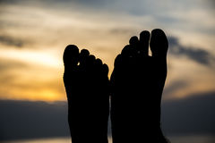 Couple feet silhuette at the beach during sunset Royalty Free Stock Photo