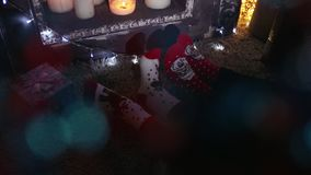 Couple Feet in Woollen Socks by the Cozy Fireplace, Man and Woman relax by warm fire and warming up their feet. Close up. Couple Feet in Woollen Socks by the stock video footage