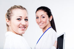 Couple of female doctors with tablet Royalty Free Stock Images
