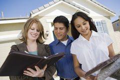 Couple With Female Estate Agent Stock Photo