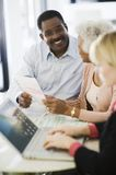 Couple With Female Financial Advisor Royalty Free Stock Image