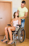 Couple with female in wheelchair near doors Stock Images