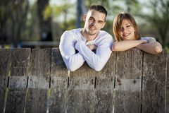 Couple by the fence Royalty Free Stock Images