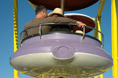 Couple on a Ferris Wheel. Couple on an amusement park ride Royalty Free Stock Images