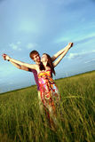 Couple in Field Stock Photo