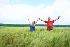 Couple in field Stock Photography