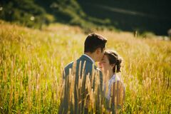 Couple in field of wheat