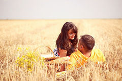 Couple in the fields having picnic Stock Photos
