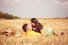 Couple in the fields having picnic Stock Image