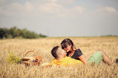 Couple in the fields having picnic Royalty Free Stock Photography