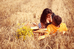 Couple in the fields having picnic Royalty Free Stock Photo