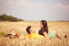 Couple in the fields having picnic Stock Photo