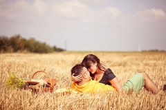 Couple in the fields having picnic Royalty Free Stock Image