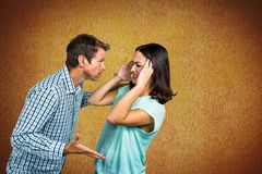 Couple fighting against yellow background Stock Images