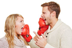 Couple fighting with boxing gloves Stock Image