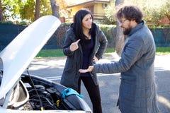 Couple fighting about broken car stock photos