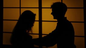 Couple fighting at home. Relations with quarrels. Silhouette. Close up. Man and woman fighting at home, marriage trouble, young couple finds out the relationship stock video footage