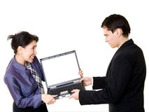 Couple fighting for laptop Royalty Free Stock Images