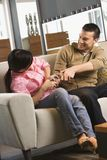 Couple fighting over remote. Royalty Free Stock Photos