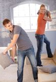 Couple fighting with pillow Royalty Free Stock Photos