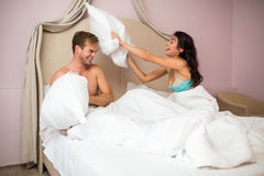 Couple is fighting by pillows. royalty free stock photos