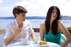 Couple fighting in vacation during breakfast on lake Stock Images