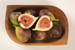 Couple of figs in a pot over a white background. Royalty Free Stock Photography