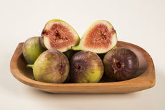 Couple of figs in a pot over a white background. Stock Image