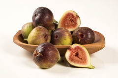 Couple of figs in a pot over a white background. Royalty Free Stock Photo
