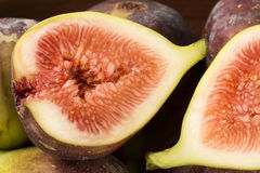 Couple of figs in a pot over a wooden table Stock Photography