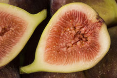 Couple of figs in a pot over a wooden table Royalty Free Stock Image