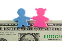Couple figurine on US dollar note Stock Images