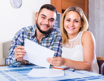 Couple filling forms for bank Stock Photo