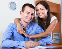 Couple filling marriage application form Stock Photos