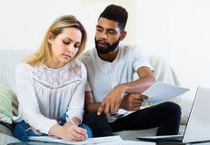 Couple filling papers for mortgage Royalty Free Stock Photography