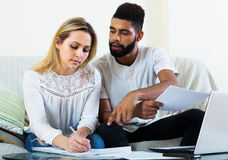 Couple filling papers for mortgage Royalty Free Stock Images