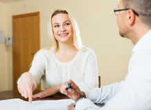 Couple filling questionnaire for employee Royalty Free Stock Photos