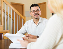 Couple filling questionnaire for employee Stock Photography