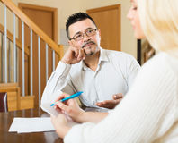 Couple filling questionnaire for employee Royalty Free Stock Images