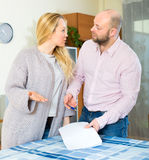 Couple filling in serious documents Stock Photo