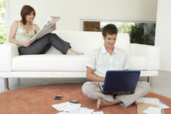 Couple Finances on Couch stock photo