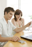 Couple Finances on Desk Stock Photography