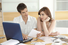 Couple Finances in Kitchen Royalty Free Stock Photography