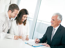 Couple with Financial Advisor Royalty Free Stock Image
